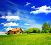 House on green hill — Stock Photo