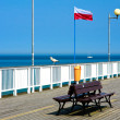 Bench overlooking the sea on pier — Stock Photo