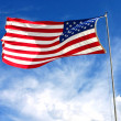 American flag on blue sky — Stock Photo #2028931