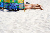 Sunbathing on the beach — Stock Photo