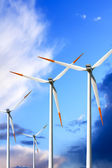 Wind turbines on blue sky — Stock Photo