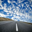 Empty road and fantastic sky - Stock Photo