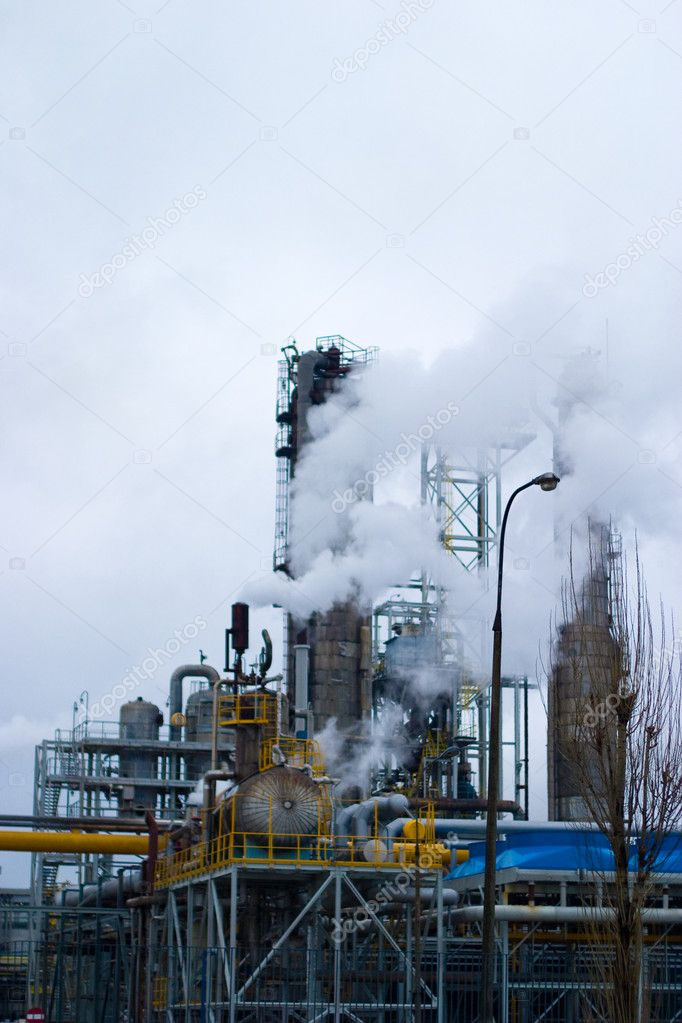 Chemical plants polluting the air with large chimneys — Stock Photo #2092803