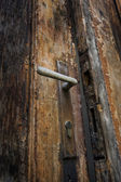 Old wooden door and latch — Stock Photo