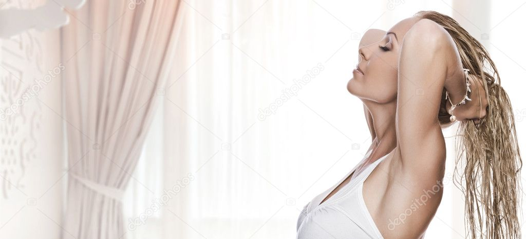 High key portrait of young beautiful woman on color  back  Stock Photo #1966482