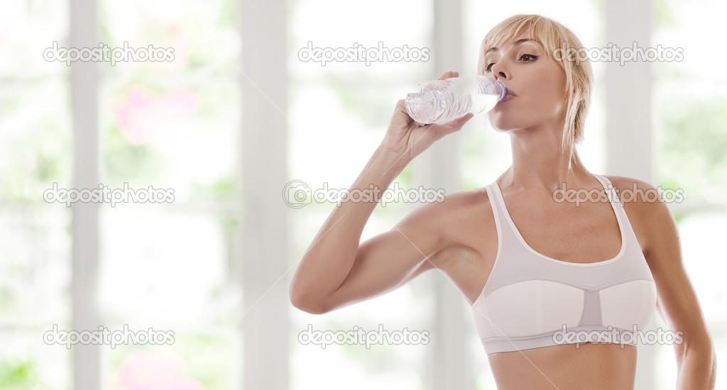 Portrait of nice young woman drinking water color back — Stock Photo #1966488