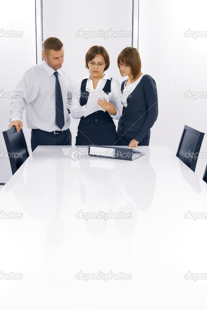 Portrait of young business discussing project in office environment — Stock Photo #1966664