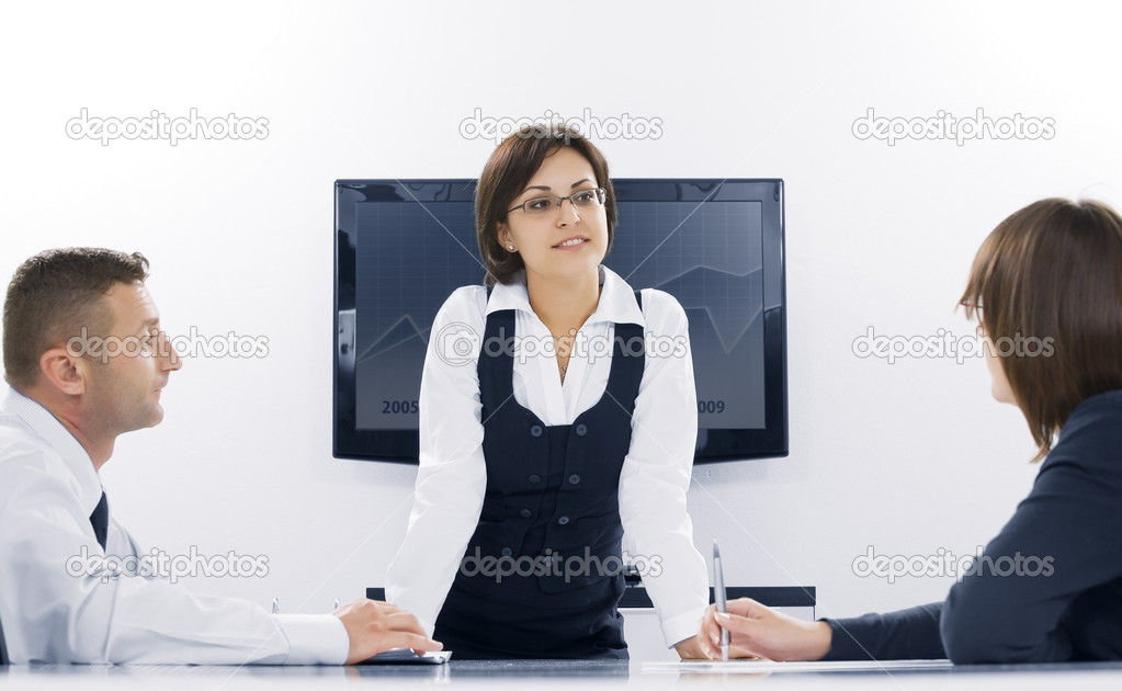 Portrait of young business discussing project in office environment — Stock Photo #1967098
