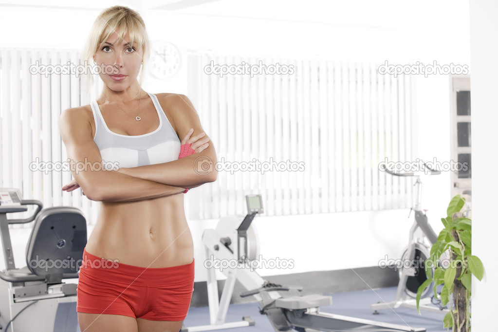 Portrait of young nice woman getting busy in gym     — Stock Photo #1967135