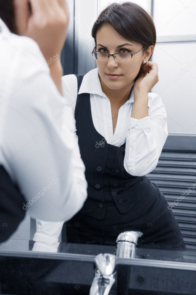 Portrait of young pretty  businesswoman in ladies room environment  Stock Photo #2000352
