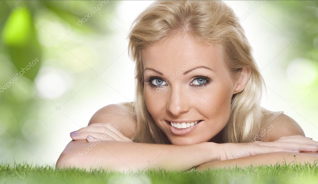 High key portrait of young beautiful woman  in summer environment  — Stock Photo #2000679