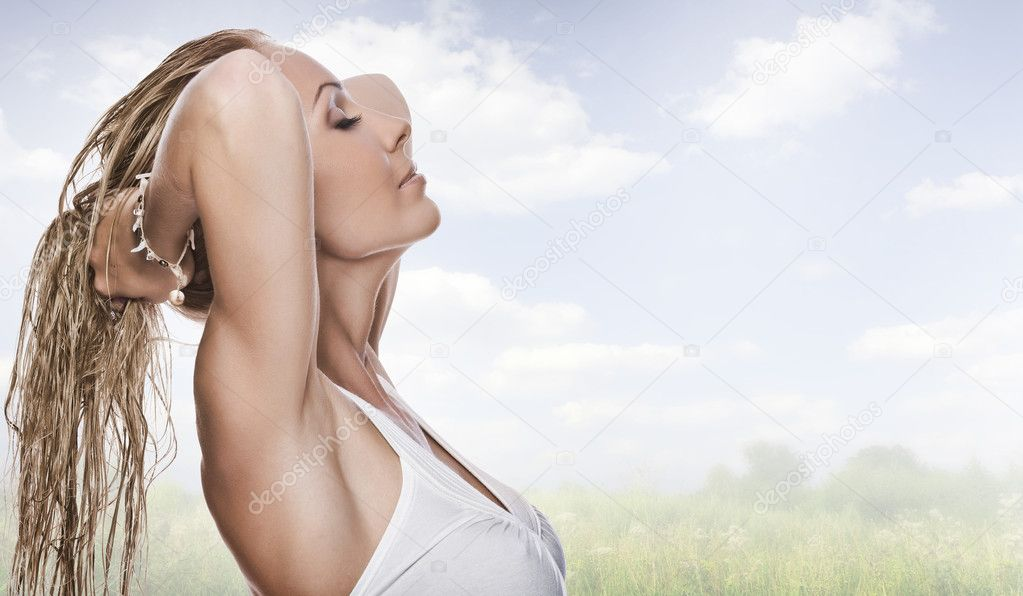 Portrait of young attractive woman having good in summer environment  Stock Photo #2429447