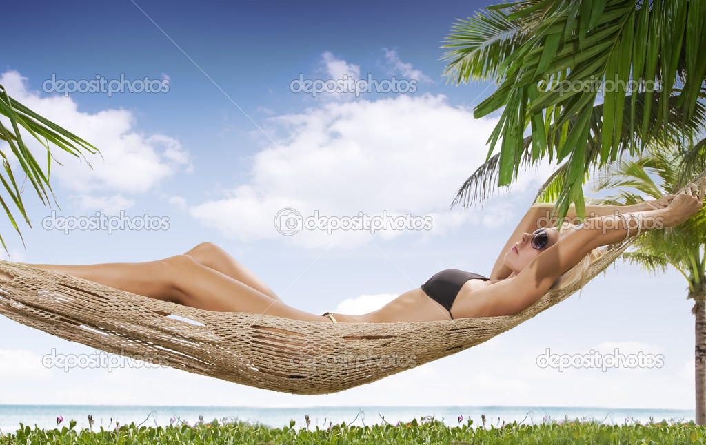 View of nice woman lounging in hammock in tropical environment — Stock Photo #2429509