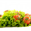 Small fresh tomatoes and lettuce — Stock Photo
