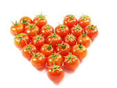 Tomatoes folded in the shape of the hear — Stock Photo