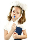 Schoolgirl with a pad and pen — Stock Photo
