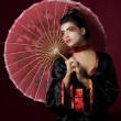 Sexy japanese geisha looking sideways - Stock Photo