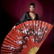 Beautiful geisha with a big fan - 图库照片