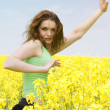 attractive girl doing yoga in rape flowe — Stock Photo