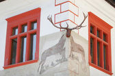 Two red windows decorated with stag horn — Stock Photo