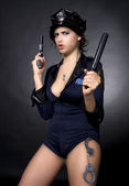 Sexy police woman holding a gun — Stock Photo