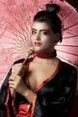 Young geisha looking at the camera — Stock Photo