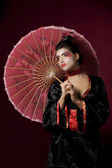 Sexy japanese geisha looking sideways — Stock fotografie