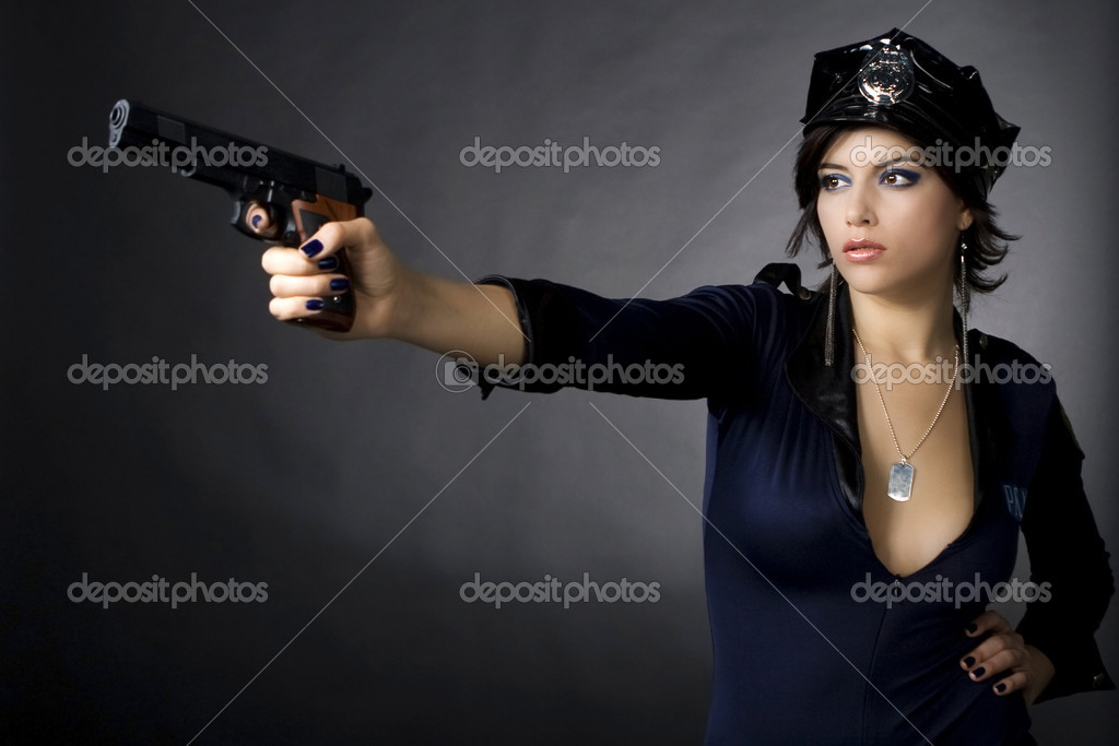Sexy woman with police uniform in studio  on dark gradient background — Stock Photo #1897880