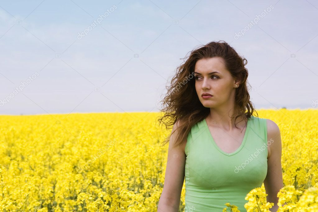 Portrait of a sad woman in rape flower field — Stock Photo #1898261