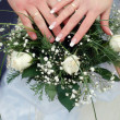 Wedding bouquet from white flowers hands — Stock Photo