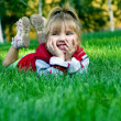 The small beautiful girl on a green lawn — Stock Photo #2619694