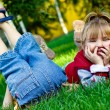 Stock Photo: Amusing children on green grass