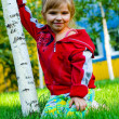 The small beautiful girl on a green lawn — Stock Photo #2619843
