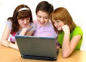 Pupils having fun on laptop — Stock Photo