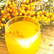 Nectar from sea-buckthorn berries - Stock Photo