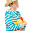 The young man in a straw hat with fruit — Foto de Stock