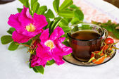 Curative tea with a dogrose — Stock Photo
