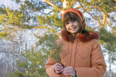 The Girl in pine wood — Stock Photo