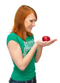 The girl holds an apple in palms — Stock Photo