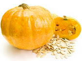 A pumpkin and pumpkin seeds — Stock Photo