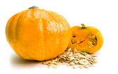 A pumpkin and pumpkin seeds — Stock Photo