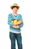 The young man in a straw hat with fruit — Stock Photo
