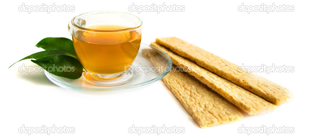 A mug of green tea and small loafs — Stock Photo #1899624