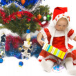 The little girl with Christmas gifts — Stock Photo #1900025