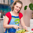 Young woman making vegetarian  salad — Stock Photo