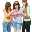 Stock Photo: Three girls look magazine