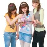 Three girls look magazine — Stock Photo