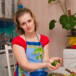 Stock Photo: Woman making vegetarian vegetable salad
