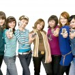 Stock Photo: Group of girls showing mobile phones