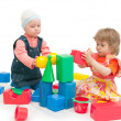 Two children play cubes — Stockfoto